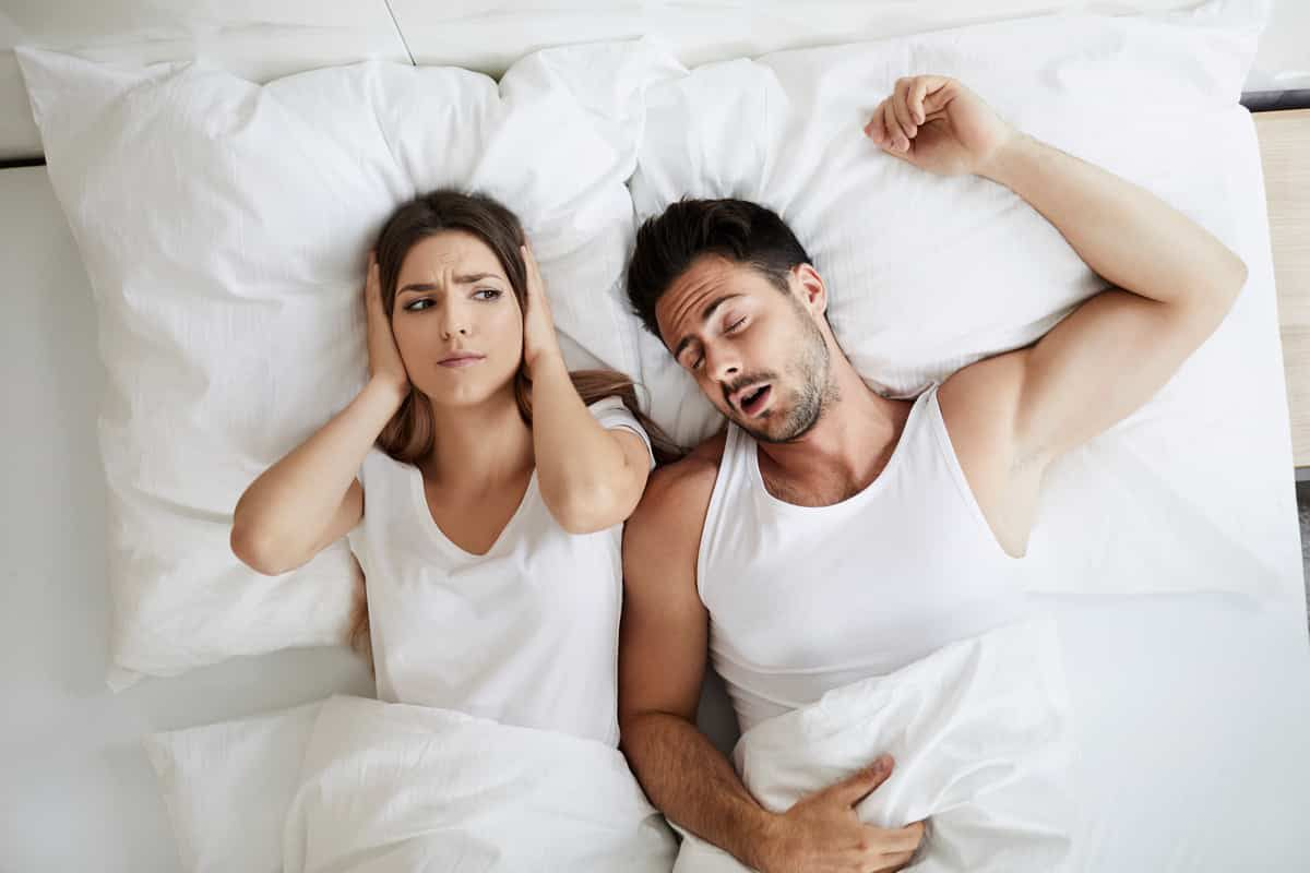 Service Featured Image - snoring male while annoying female partner